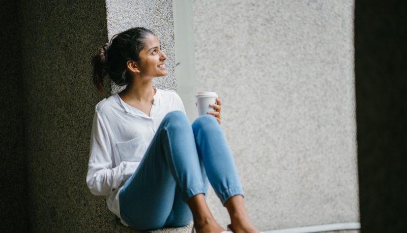 woman-posing-wearing-white-dress-shirt-sitting-on-window