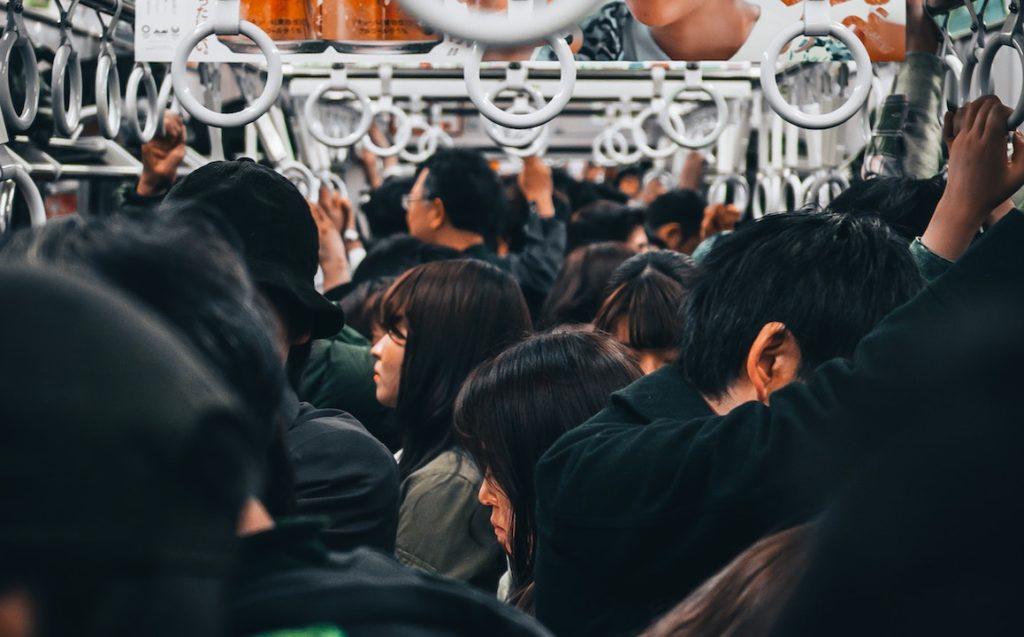 people-standing-inside-train