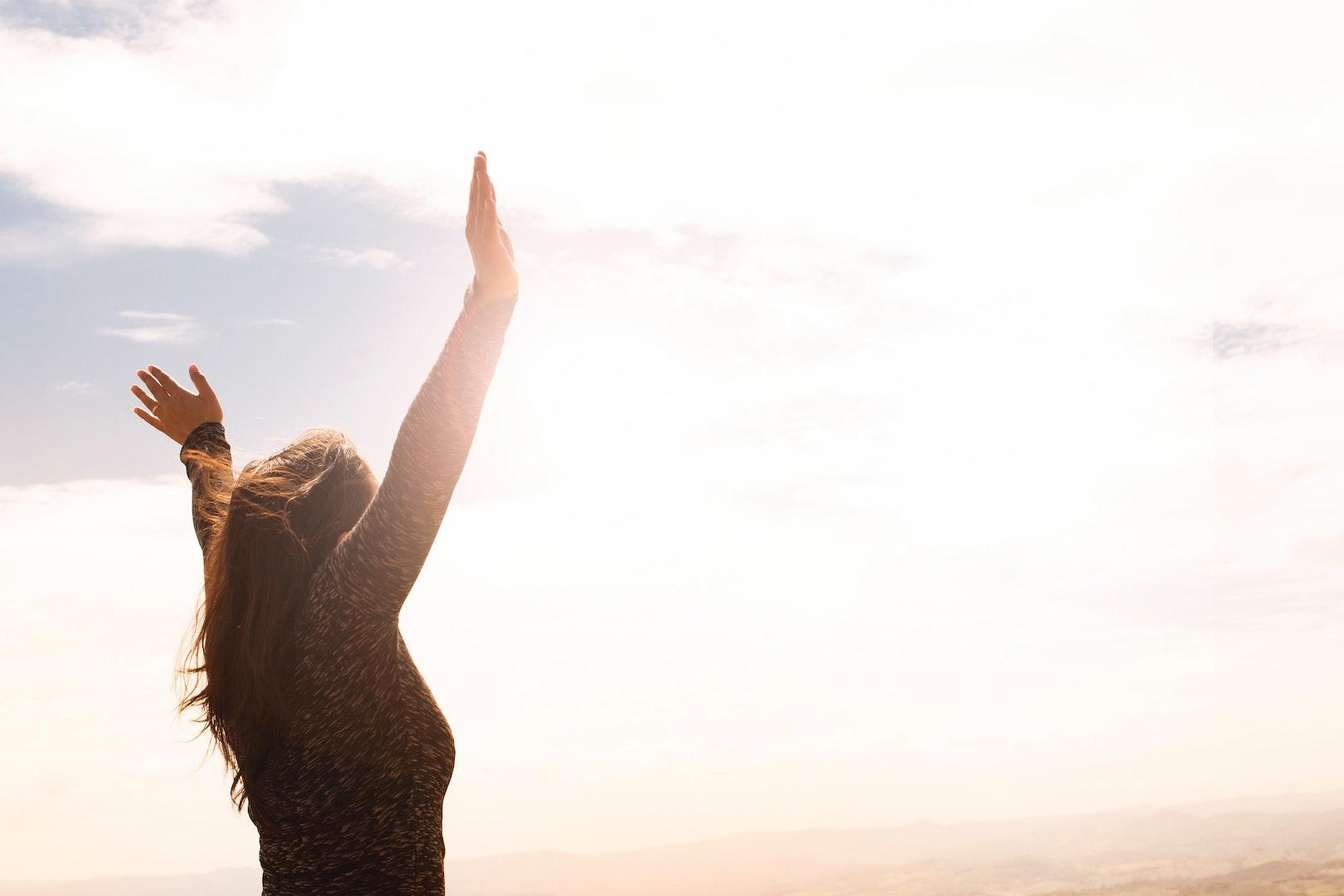 woman-raising-both-hands
