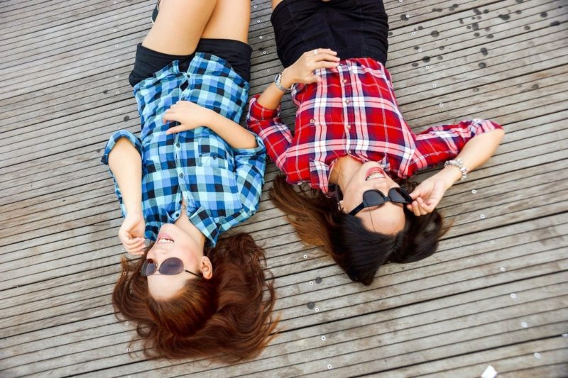 two_woman_laying_down