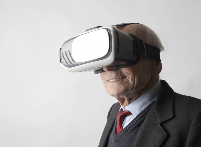 senior-man-using-vr-goggles-in-studio