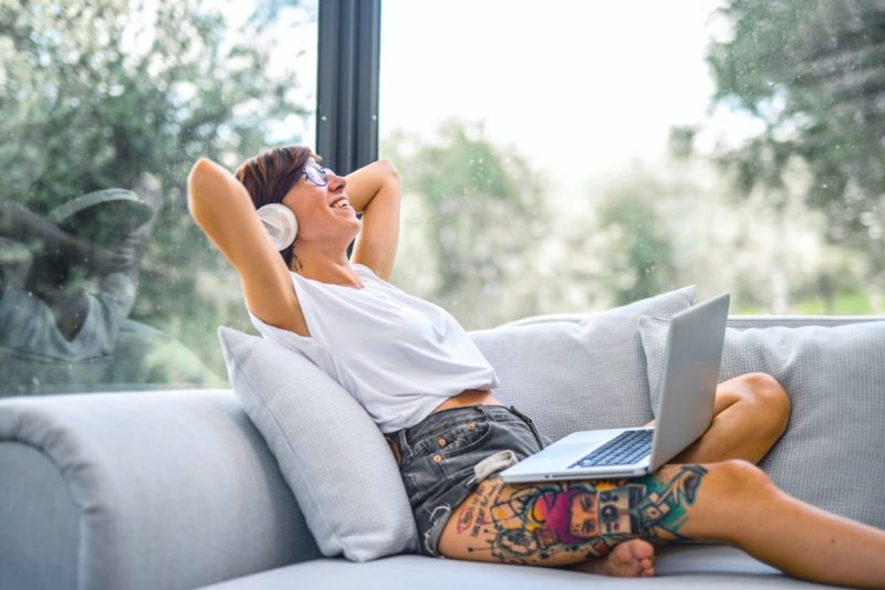 woman-sitting-on-couch